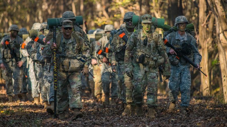 The University of Mississippi's Army ROTC reached its 100th year in 2018. Pictured: Army ROTC cadets ruck march down UM's South Campus Trails in 2017. Photo by Kevin Bain
