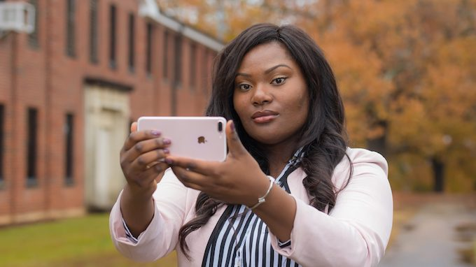 UM sophomore Yasmine Malone uses her iPhone to take photos that have appeared in The New York Times. Photo by Kevin Bain/Ole Miss Digital Imaging Services