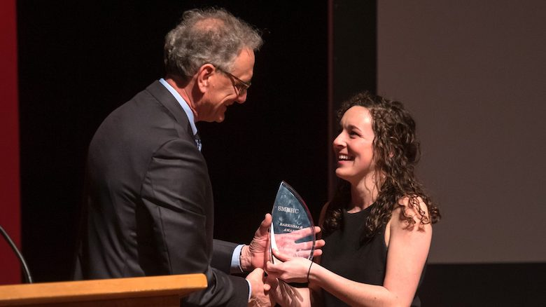 Douglass Sullivan-Gonzalez (left), dean of the UM Sally McDonnell Barksdale Honors College, presents the 2019 Barksdale Award to Maureen Maher during the annual spring Honors Convocation. Photo by Kevin Bain/