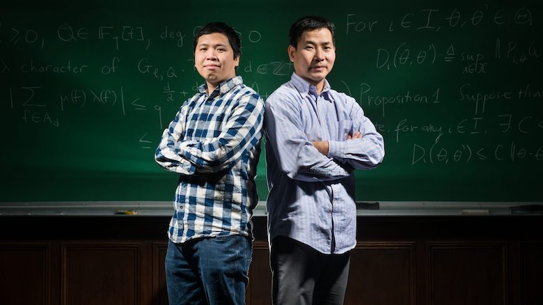 University of Mississippi Math Professors Thái Hoàng Lê, left, and Dao Nguyen, right, both hold gold medals in the International Mathematical Olympaid as high school students in the 1990s. Photo by Megan Wolfe