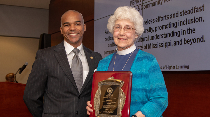 Dr. Steven Cunningham (left), chair of the IHL Diversity Committee, congratulates retired educator Peggy Sisson on being honored with the board's Karen Cummins Community Service Award.