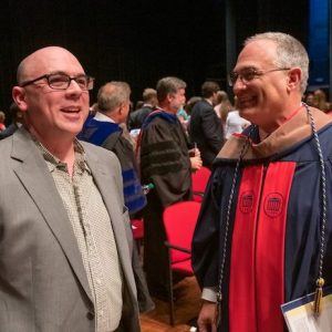 UM psychology professor John Young (left) talks with Interim Chancellor Larry Sparks after receiving the 2019 Elsie M. Hood Teacher of the Year Thursday evening (April 4) at Honors Convocation. Photo by Kevin Bain/Ole Miss