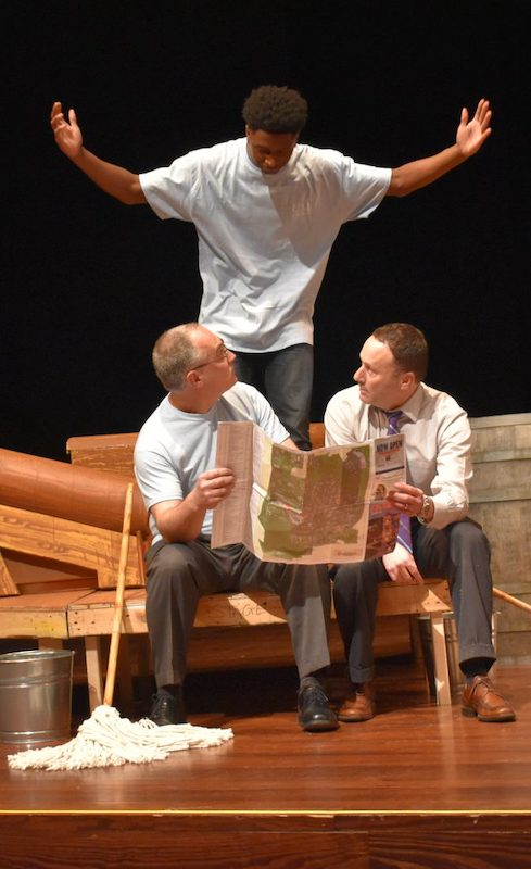 UM student Ontarius Woodland (top) catches Interim Chancellor Larry Sparks and Dean Lee Cohen sitting down on the job during a scene from the comic musical 'H.M.S. Pinafore.'