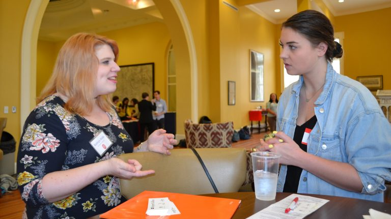 Kayleigh Webb (left) an associate publicist with HarperCollins Publishers, shares career advice with UM junior Emily Capponi, of Seattle. Webb advised students at the networking event to accept 'no' graciously during their job search because in her case, those rejections eventually led her to a fulfilling career. Photo by Pam Starling/Division of Outreach