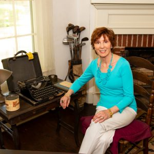 Sandy Black sits in the office of William Faulkner's home.