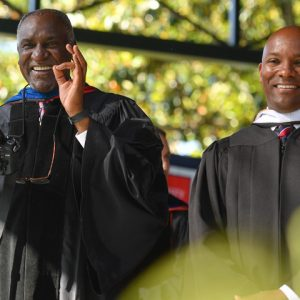 Donald Cole (left), pictured here with state Institutions of Higher Learning Trustee Shane Hooper at a UM Commencement, is being honored with a named scholarship for his devoted work as a faculty member, administrator, mentor and advocate. The Cole scholarship will assist African American Studies majors and encourage them to get involved in the university and pursue progressive change across Mississippi.