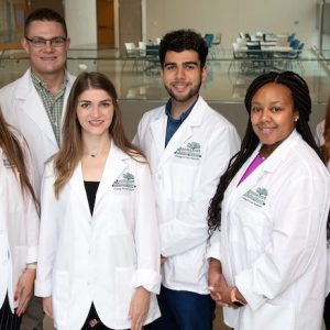 UM students and alumni who have been selected for the the undergraduate portion of the Mississippi Rural Physicians Scholarship Program for 2019 are (from left) Jamie Johnson, Cole Stephens, Katelyn Barnes, Nader Pahlevan, Jamie Riggs and Riley Brown. Photo by Jay Ferchaud