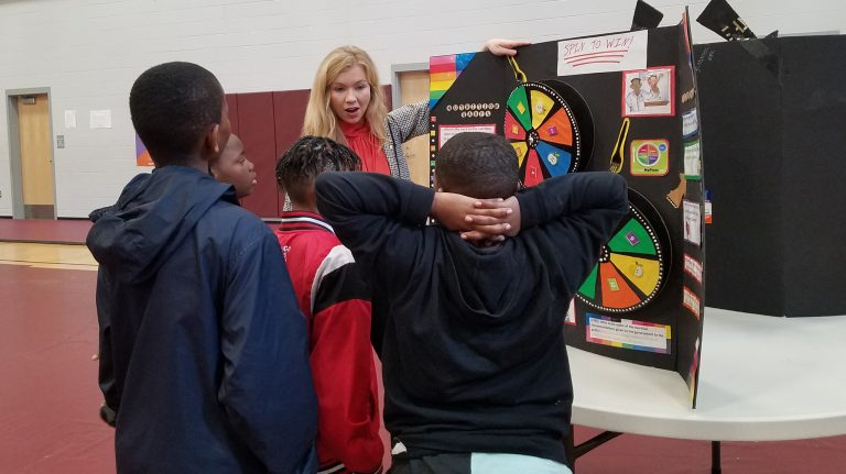 Sydney Mitchell, a senior UM biochemistry major from Raymond, teaches Quitman County middle schoolers how to read nutrition labels at the College2Youth health fair.