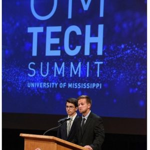Gunner Rhoden, a biochemistry major (left), and Silvio Valladao, an exercise science graduate student, discuss Physiological Responses to Esports at the fourth Tech Summit. UM photo