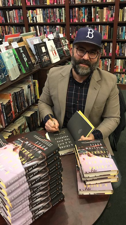 UM alumnus and instructor Bill Boyle signs book copies following a reading at The Mysterious Bookshop in New York. Photo: Charles Perry