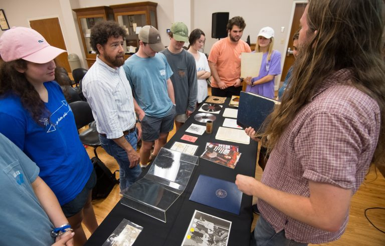 Students in Jimmy Thomas' LIBA 102 class get an up-close look at rare documents, photos and other resources at the J.D. Williams Library's Department of Archives and Special Collections. Photo by Kevin Bain/Ole Miss Digital Imaging Services