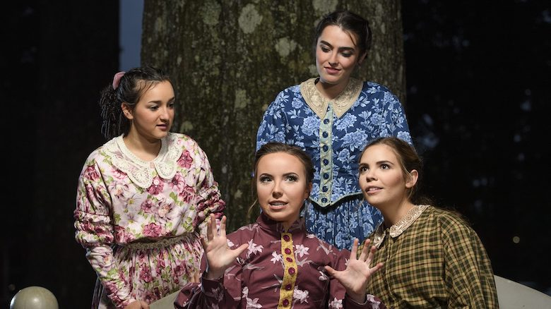 Jo March (center), played by Lydia Meyers, spins a swashbuckling tale for sisters (from left) Amy, portrayed by Cali Mitchell; Meg, played by Ginnie Brown; and Beth, performed by Elizabeth Burrow, during rehearsals for the Ole Miss Theatre and Film production of 'Little Women.' Photo by Thomas Graning/Ole Miss