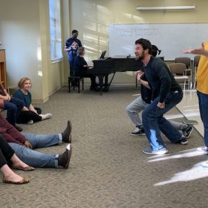 Benjamin Rorabaugh (center, left), a master's student in vocal performance from Long Beach; Jiaxuan Zhu (behind), a master's student in vocal performance from Wenzhou, China; and Reagan Arnold, a senior vocal performance major from Collins, entertain fellow cast members with a scene from Gilbert and Sullivan's 'Princess Ida.' The scene is part of the UM Opera Scenes program 'Be in the Room Where it Happens,' set for Nov. 1 and 2 in Nutt Auditorium. Photo by Lynn Adams Wilkins/