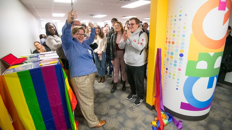 Jaime Harker, University of Mississippi professor of English and director of the Isom Center for Women and Gender Studies, cuts the ribbon on UM's new LGBTQ+ lounge inside Lamar Hall. Photo by Kevin Bain/