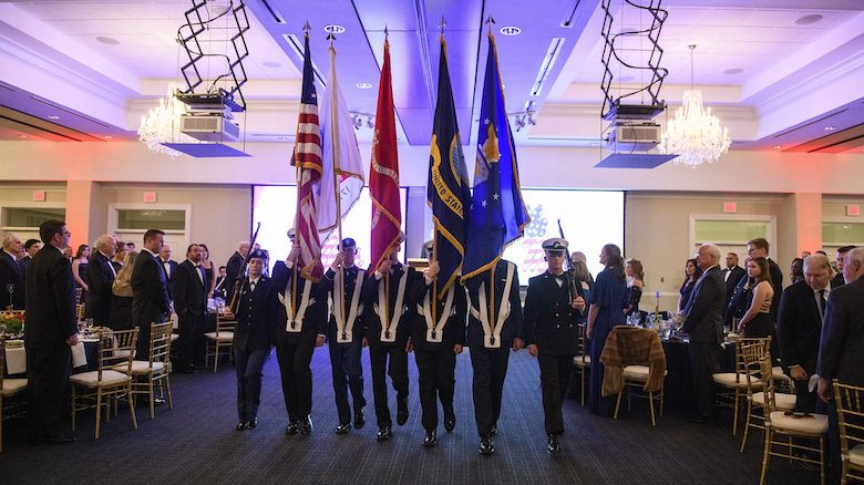 A color guard of the University of Mississippi ROTC programs displays the flags of their respective military units during a Veterans Day celebration at the Inn at Ole Miss. Photo by Thomas Graning/Ole Miss
