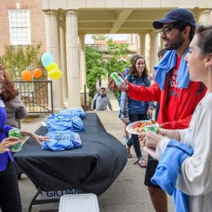 Anne Twitty (left), associate professor of history, greets students during the Department of History's undergraduate open house outside of Bishop Hall on the Oxford campus.