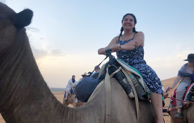 UM junior Isabel Spafford rides a camel in Morocco, where she spent her summer on an immersive experience of language and culture studies through the university's Arabic Language Flagship Program.