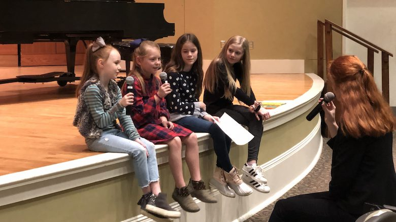 Rebecca Cohen (left), Nora Lynch, Laney Schuesselin and Mary Helen Rhodes talk with Ava Street, executive director of 'Thacker Jr. Radio Hour,' during host auditions.