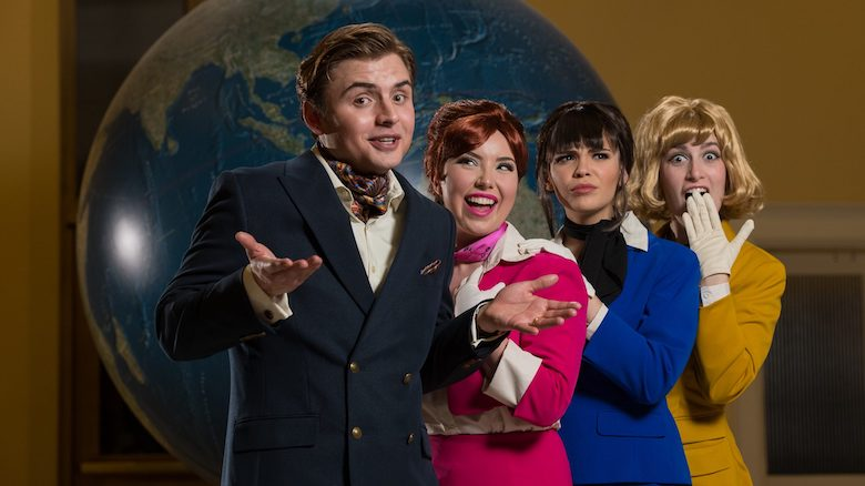 Keeton Landfair (left) plays Bernard, an American playboy in Paris who is juggling three fiancees, all airline stewardesses, played by Lydia Meyers, Elizabeth Burrow and Hannah Bosworth, in the Ole Miss Theatre production of 'Boeing, Boeing.' Photo by Kevin Bain/Ole Miss