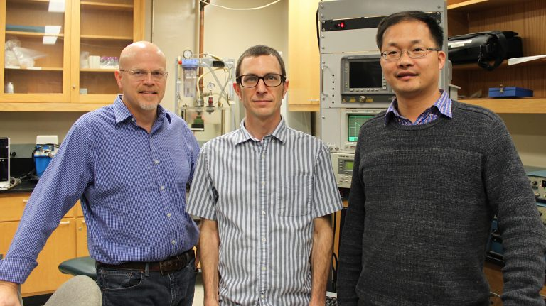 UM researchers Joel Mobley (left), Robert Lirette and Likun Zhang have published a Physical Review Applied paper announcing that they have sonically captured a droplet and moved it without any direct or mechanical contact using a technique called near-field acoustic tweezers. Photo by Shea Stewart