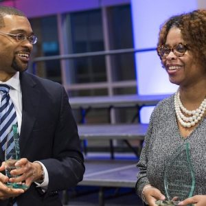 "Patrick Alexander (left), UM associate professor of English and African American studies, and Nichelle Robinson, associate professor of teacher education and School of Education diversity officer, share a moment after being presented their 'Lift Every Voice"" awards in the Ole Miss Student Union Ballroom. Photo by Christian Johnson/Ole Miss"
