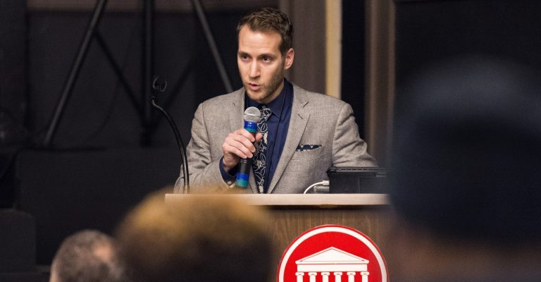 Garrett Felber, a UM assistant professor of history who spearheaded planning efforts for the 'Black Power at Ole Miss' events, reads the demands black students made of the university in 1970, most of which have been met, noting some still haven't. Photo by Christian Johnson/ Ole Miss Digital Imaging Services