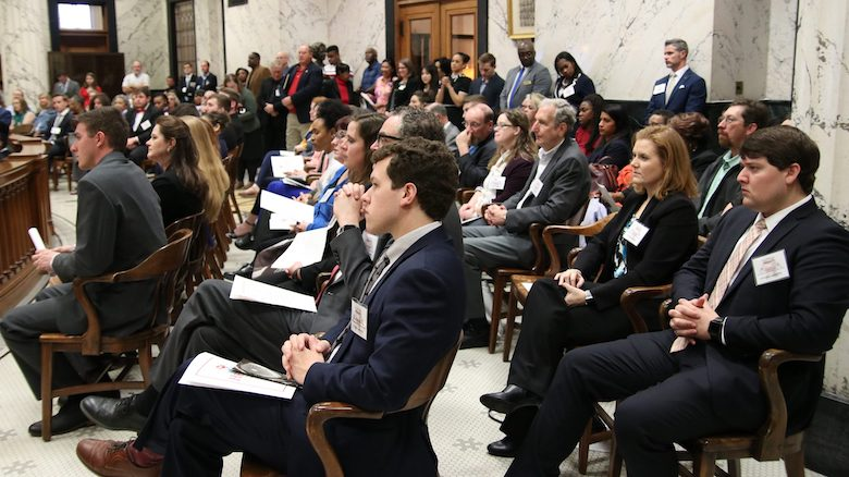 Jared Akers (right), a dental student at the UM Medical Center, and Jennifer Bain (second from right), associate professor and chair of periodontics at the Medical Center, attend a recognition ceremony for all the 2020 HEADWAE Awards recipients at the state Capitol in Jackson. Photo by Tammi Bowles