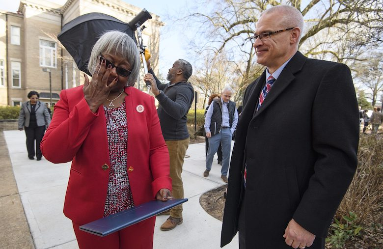 Linnie Liggins (left) reacts to finally receiving the University of Mississippi diploma she earned 50 years after completing her coursework. Provost Noel Wilkin apologized earlier in the day that the university neglected to recognize her accomplishments for so long and said he was ready to present her diploma whenever she was ready, on her terms. Photo by Thomas Graning/Ole Miss Digital Imaging Services