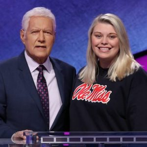 UM sophomore Londyn Lorenz poses for a publicity photo with legendary host Alex Trebek on the set of 'Jeopardy!' during the Jeopardy! College Challenge. Photo courtesy Jeopardy Productions Inc.