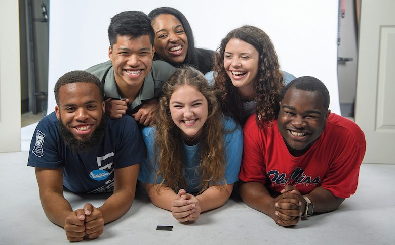 Joshua Mannery (left) participates in a photo shoot with fellow 2019 orientation leaders at the University of Mississippi: (bottom from left) Shelby D'Amico and Mister Clemmones, and (top, from left) Eric Pham, Jon'na Bailey and Ameleigh Bippen. Photo by Thomas Graning/Ole Miss