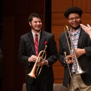Ricky Salazar (left), a UM master's student in music, and undergraduate music students Jesse Gibens and Quayshun Shumpert wrap up performance as part of a master class earlier this year as Nancy Maria Balach, interim chair of music, applauds. Photo by Kevin Bain/Ole Miss