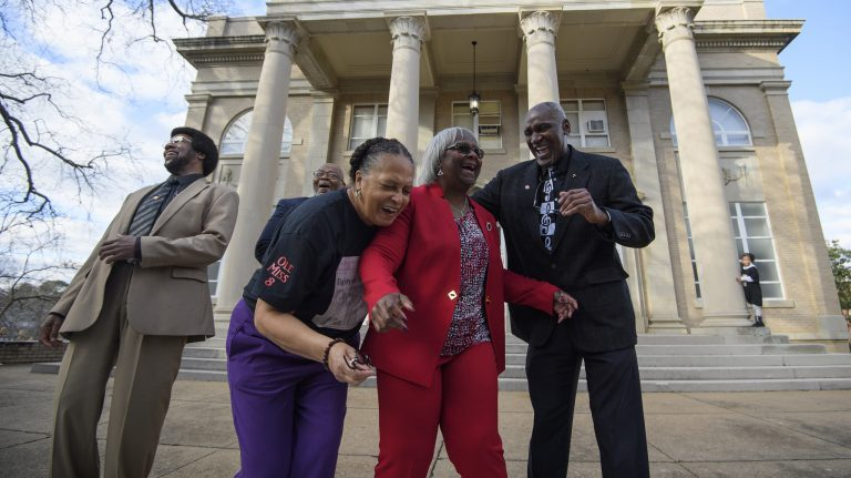 Kenneth Mayfield (left), Dr. Theron Evans Jr., Henrieese Roberts, Linnie Liggins, and Donald Cole remember their time as UM students in the very spot where they were arrested for protesting 50 years ago. Photo by Thomas Graning/Ole Miss Digital Imaging Services