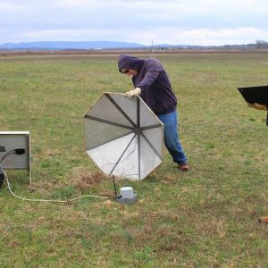 Brian Carpenter (left) and Hank Buchanan, two research and development engineers at the University of Mississippi's National Center for Physical Acoustics, work on an infrasound array sensor at Alabama A&M University's Winifred Thomas Agricultural Research Station north of Huntsville. Photo by Shea Stewart
