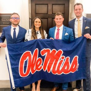 UM student veterans Winston Taylor (left), Lauren Graham and Jamie King show off an Ole Miss flag with Andrew Newby, UM assistant director for veterans and military services, in front of U.S. Rep. Trent Kelly's office In Washington, D.C. The flag was originally carried to Iraq by King when he was deployed there with the U.S. Army's 82nd Airborne Division.