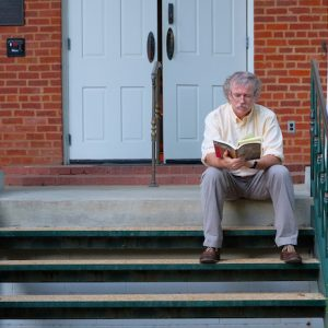 Ted Ownby, former director of the UM Center for the Study of Southern Culture, reads outside Barnard Observatory. Ownby has received a Fulbright Award to teach and conduct research at the University of Southern Denmark. Photo by Robert Jordan/Ole Miss Digital Imaging Services