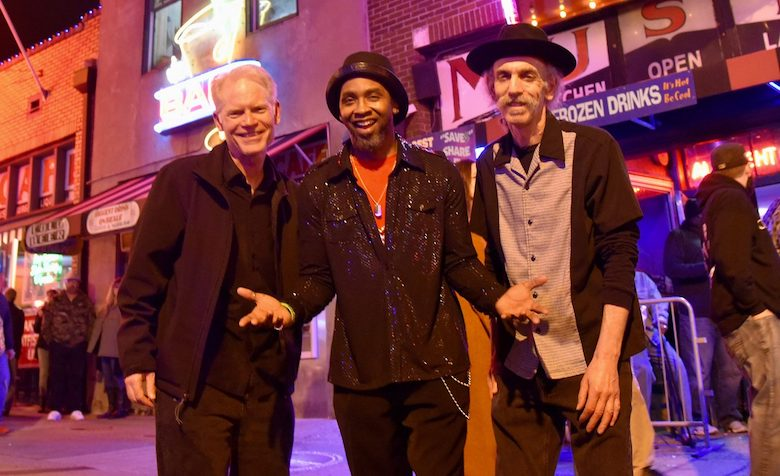 UM professors Adam Gussow (left) and Alan Gross (right), and bandmate Rod Patterson hang out on Beale Street in Memphis. Submitted photo