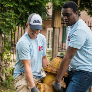 Archive Photo: UM students work to move a fire hydrant during an M Partner Community Day event in 2018. M Partner was launched as a community engagement effort seeking to improve life in Mississippi communities, specifically in Charleston, Lexington and New Albany for the pilot phase. Photo by Megan Wolfe/Ole Miss Digital Imaging Services