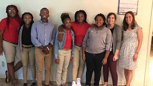 Curtis Hills (third from left) with participants in a resume-building workshop at the Nollie Jenkins Family Center in Durant.