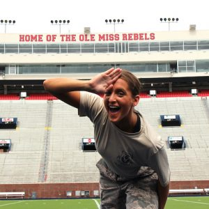 Megan Steis, a UM senior majoring in Chinese, celebrates being named a 2020 Navy Federal Credit Union Air Force ROTC All-American by showing off a landshark sign at Vaught-Hemingway Stadium. Photo by Avary Hewlett