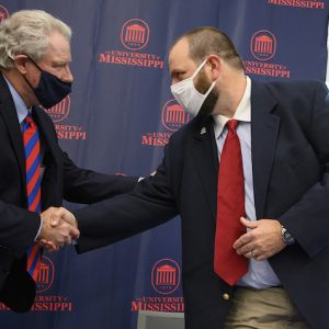 Chancellor Glenn Boyce (left) and Ecru Mayor Jeff Smith shake hands after signing M Partner agreements on Friday (Jan. 22). Photo by Thomas Graning/Ole Miss Digital Imaging Services