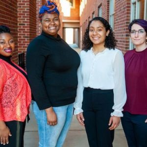 Annexstad Honors College scholars Ajah Singleton and Elsi Muñoz Ramos (second and third from left) are pictured with Rachel Coleman (left), Minority Engagement Council advisor, and Ashleen Williams, faculty mentor for the First-Generation Student Network.
