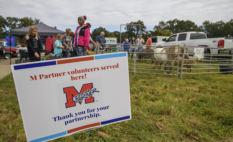M Partner volunteers serve at community day in Charleston. The University of Mississippi program that partners with local communities is working with the Pontotoc Chamber of Commerce to host Wednesday meeting to help small business owners get access to resources and funding through the CARES Act and other small business programs. Photo by Thomas Graning/Ole Miss Digital Imaging Services