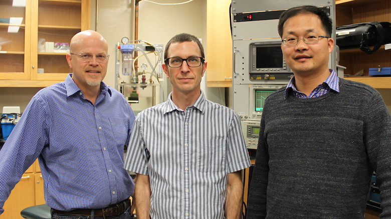 UM physics professor Likun Zhang (right) recently earned the R. Bruce Lindsay Award from the Acoustical Society of America. Part of Zhang's research involves work with physics professor Joel Mobley (left) and postdoctoral research associate Robert Lirette that sonically captures a droplet and moves it without any direct or mechanical contact, using only acoustic waves. Photo by Shea Stewart/University of Mississippi