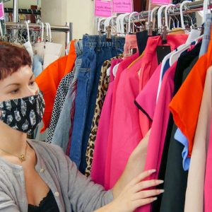 """Aryana Gaines, a senior from Thompson's Station, Tennessee, who is pursuing a major in design and theatre production, examines the costumes she worked to design for Ole Miss Theatre's upcoming production of """"Legally Blonde."""""""