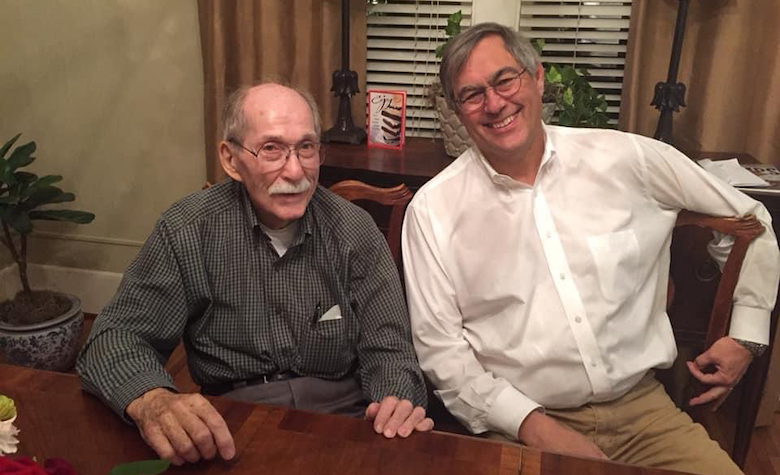 Luther Knight (left) and son Scott spend time together at home. Submitted photo