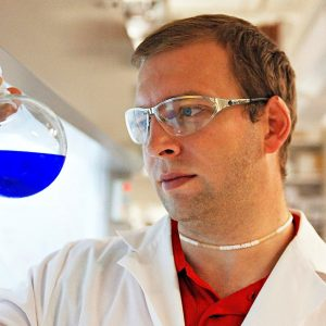 Jared Delcamp, an associate professor of chemistry and biochemistry in the lab