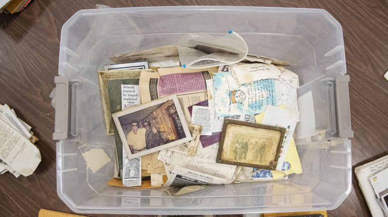 A plastic bin of photographs, papers and other personal effects of M.B. Mayfield awaits sorting and cataloging by UM researchers.