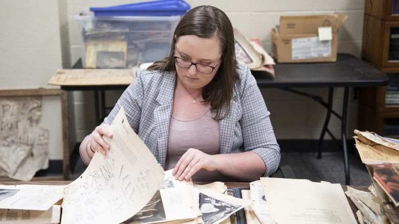 Monica Campbell, a doctoral student in history at the University of Mississippi, goes through sketches and other materials belonging to folk artist M.B. Mayfield. The material will be part of the collections and exhibits of a new museum and cultural center in Ecru that will showcase Mayfield's work and personal effects.